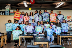 Students tie dyed t-shirts with the technique of their choice in Art 2 class.