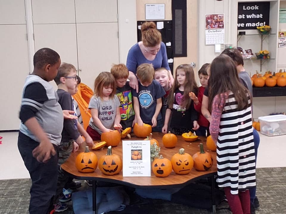 Students carving pumpkins
